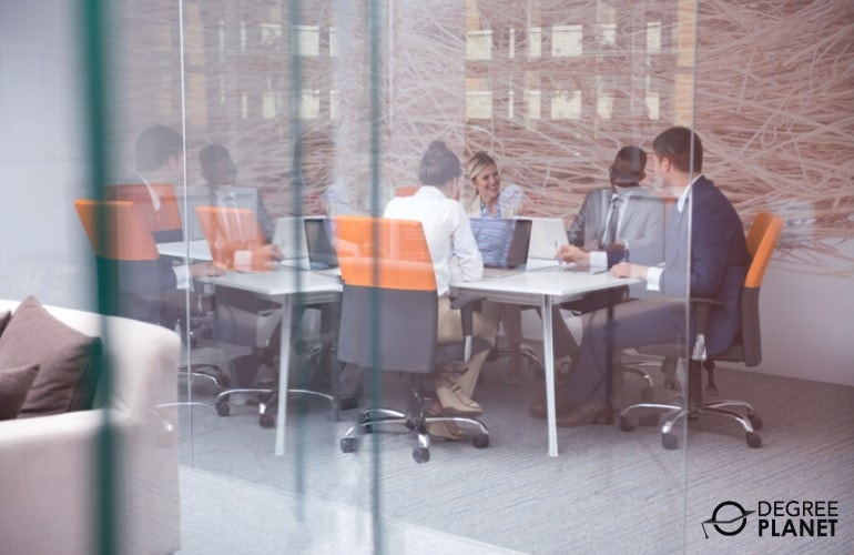 team of business professionals having a meeting in a conference room