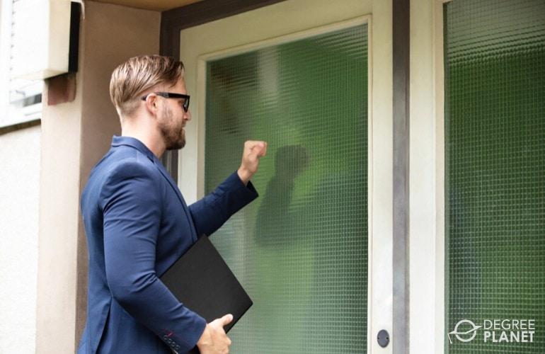 Bailiff knocking on door