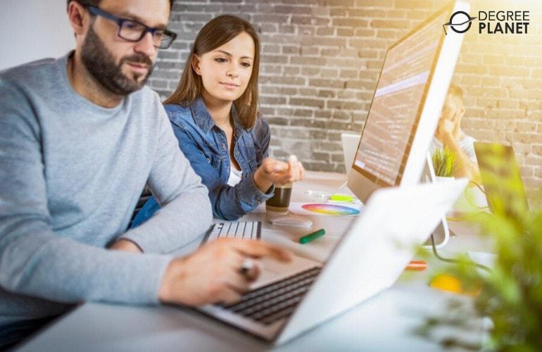 web developers working together on laptop