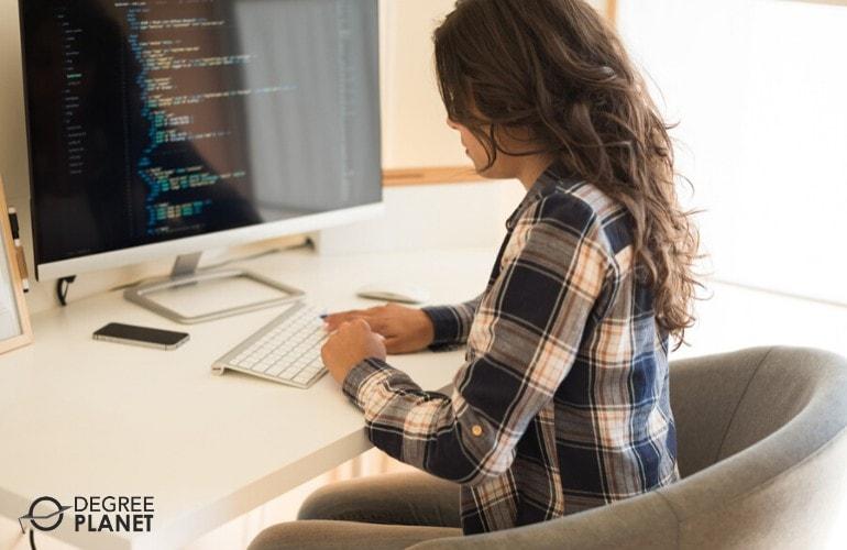 computer programmer working on her computer