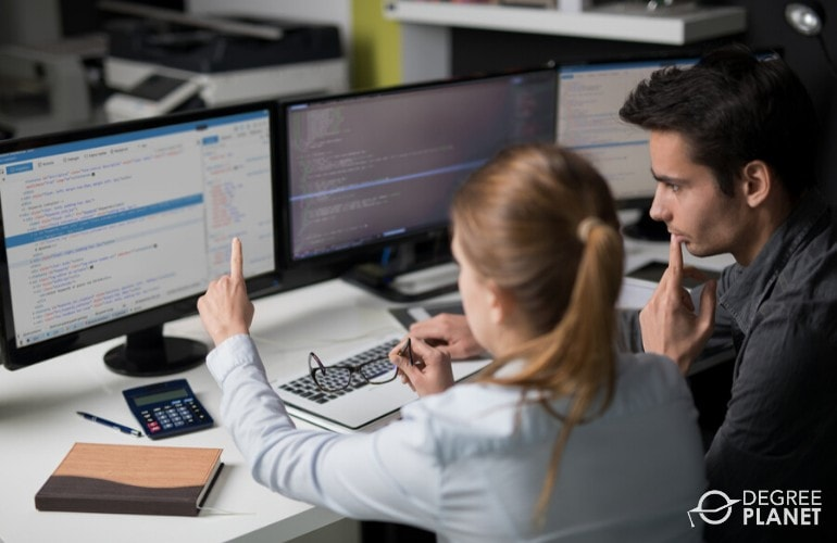web developers working in front of computer