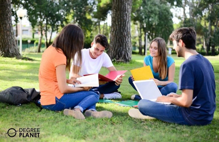 general studies degree students studying on campus grounds