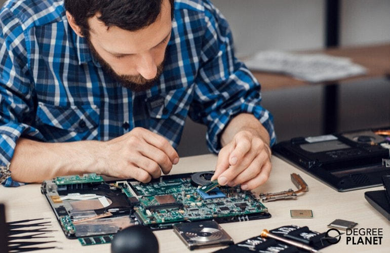 hardware engineer fixing computer parts