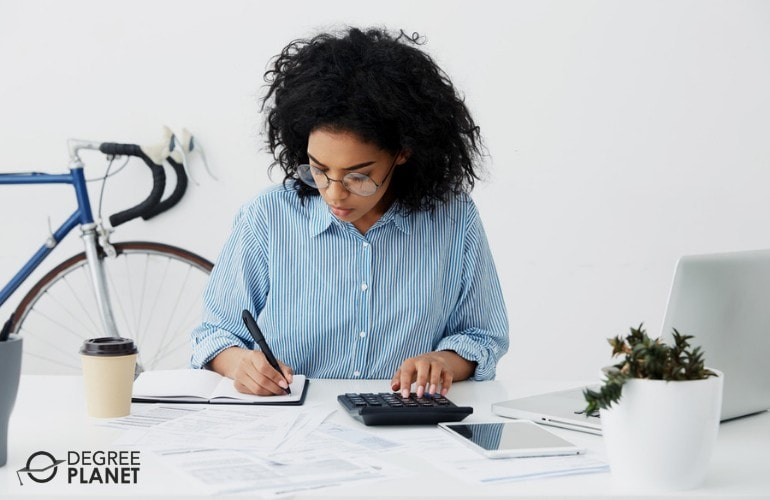 business owner checking financial reports of her business
