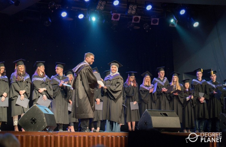 graduating accounting degree students receiving their diploma