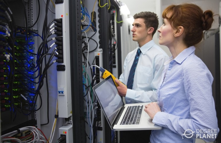 Computer Support Specialist analyzing server in a data room