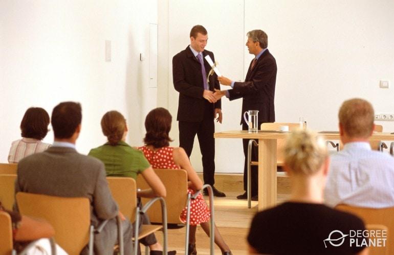 IT specialist receiving a certificate