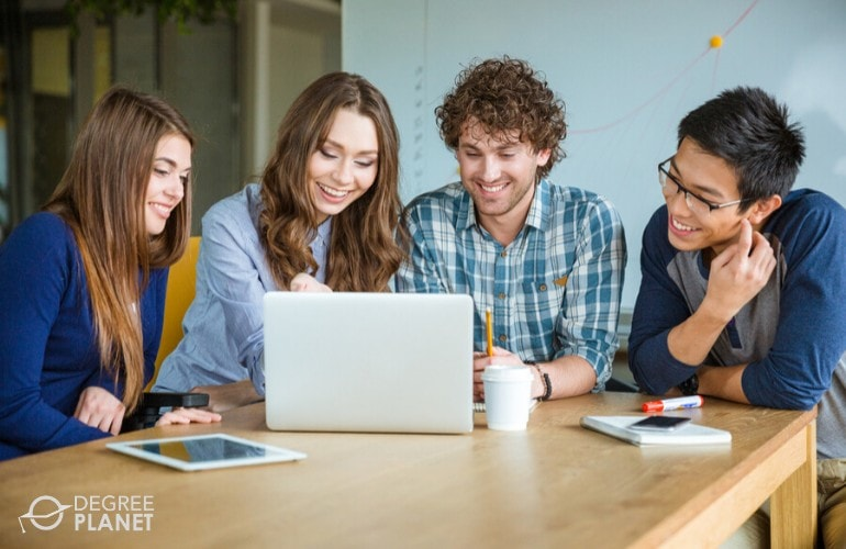 business degree students studying together