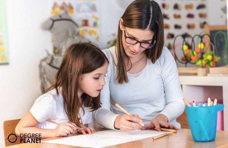 preschool teacher teaching a child how to write