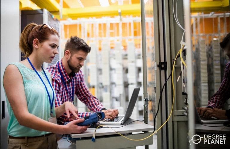 data engineers checking data center
