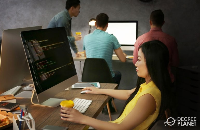 team of software developers working in an office