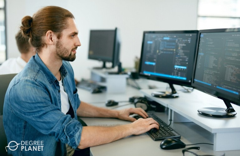 web developer working on his computer