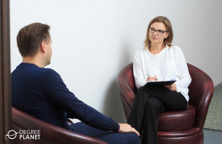 counselor listening to her client during counseling session