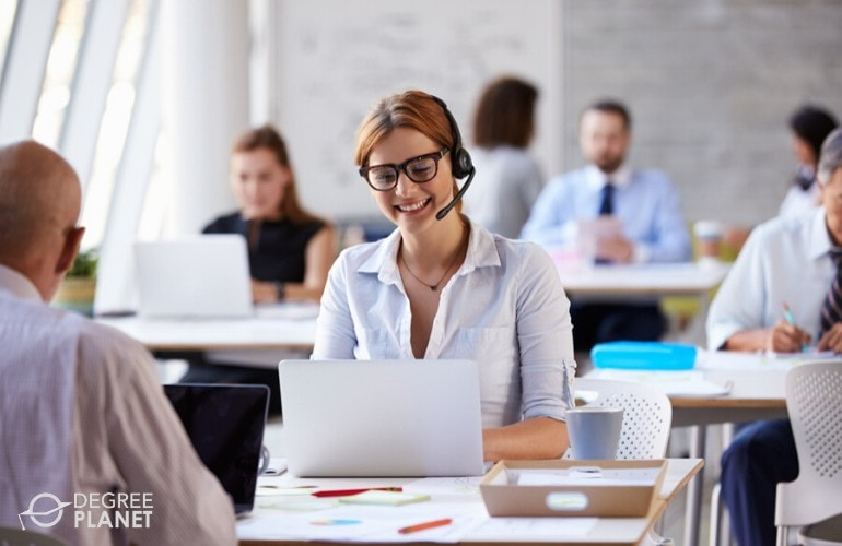 Customer service associate cheerfully talking to a customer on the phone