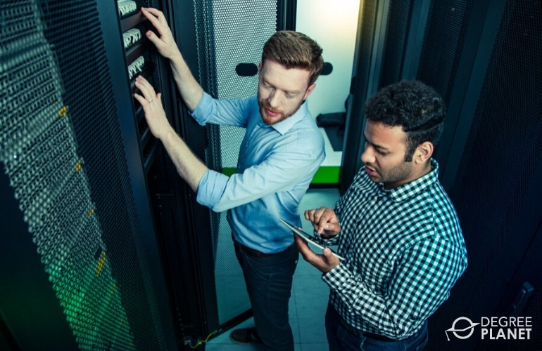 Database administrators checking the data center