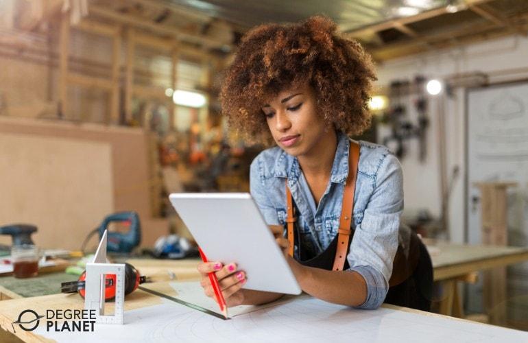 entrepreneur working on her tablet