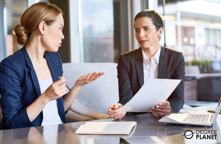 financial managers working together on financial reports