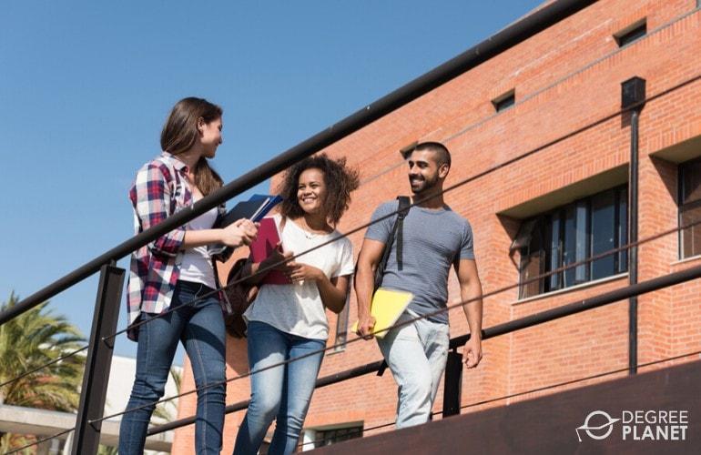 general studies students walking in university campus