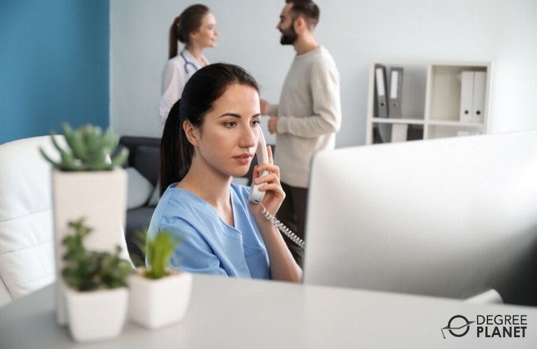 administrative support specialist talking to a patient on the phone