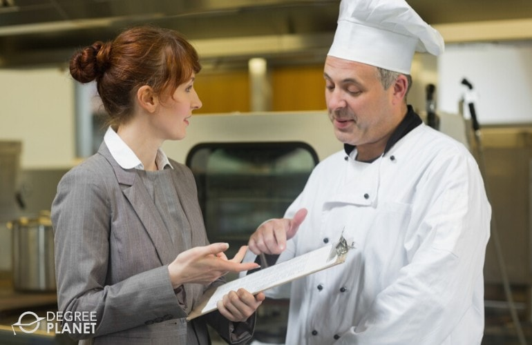 hotel manager talking to a chef