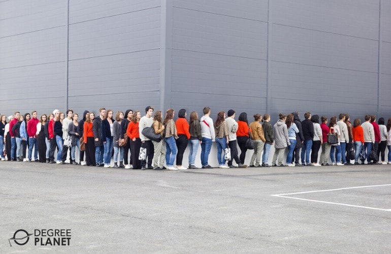 group of people waiting in a long line