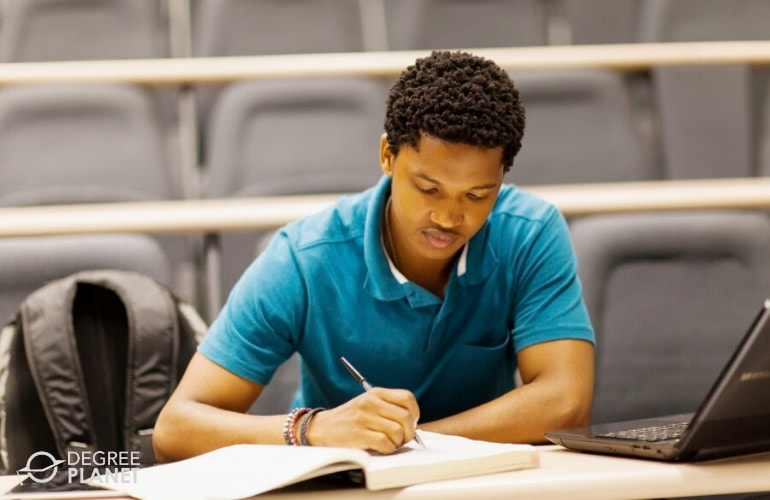 general studies degree student studying in a classroom
