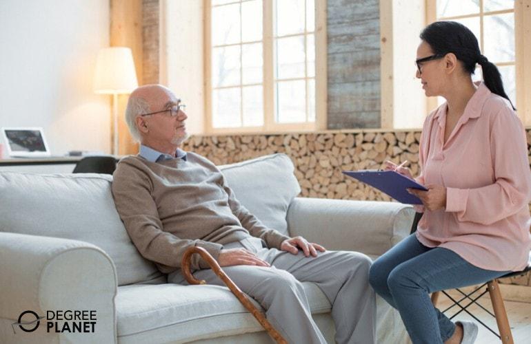 social worker interviewing an elderly man