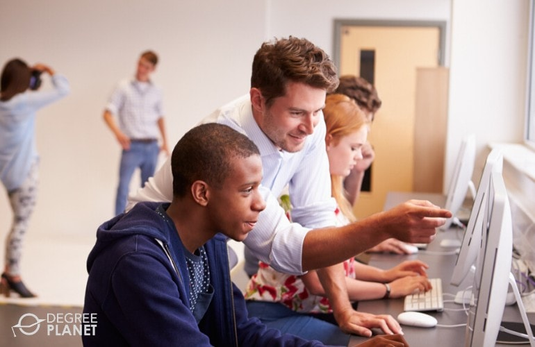 college students working on their activity during computer class