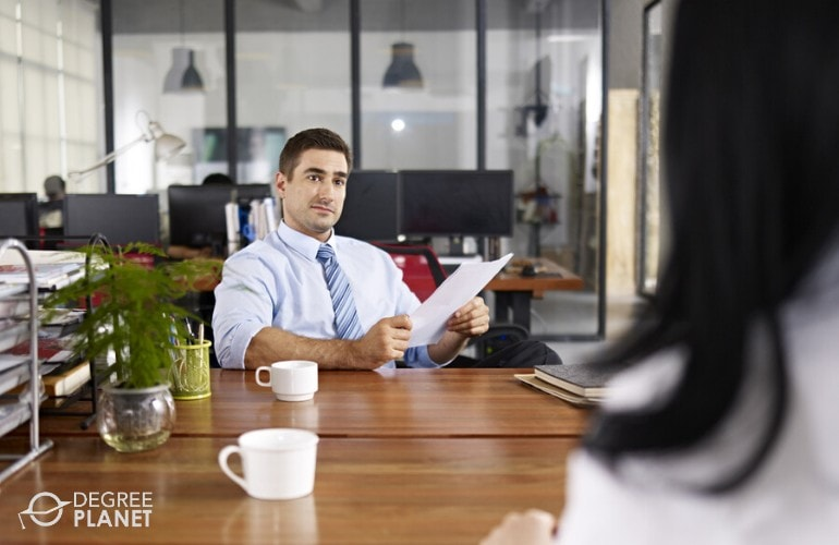 human resource manager listening to a job applicant during interview