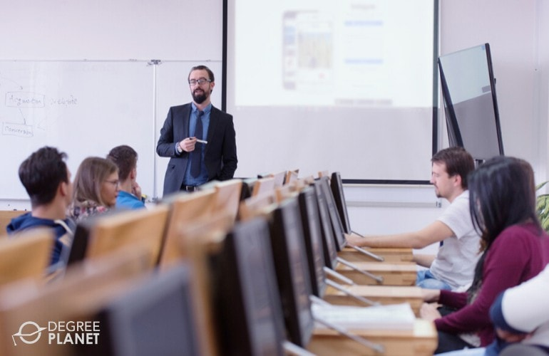 university professor teaching in a computer classroom