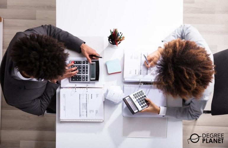 accountants working together on financial reports