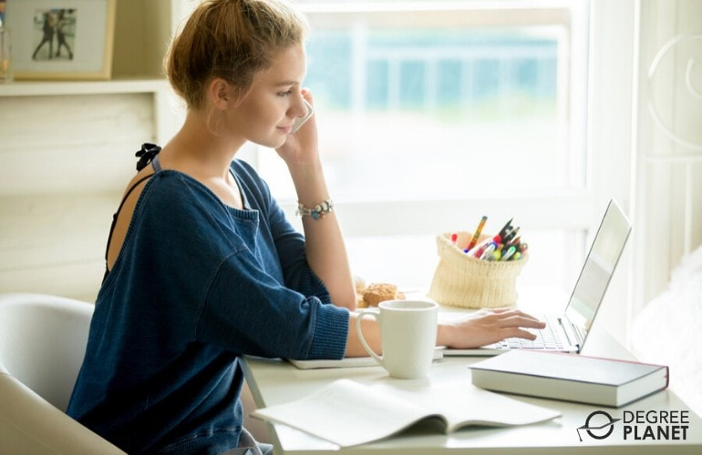 student studying on her computer at home