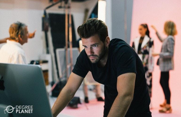 art director checking photos during photo shoot
