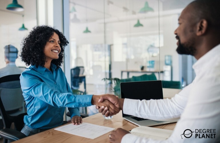 hr manager shaking hands with a job applicant
