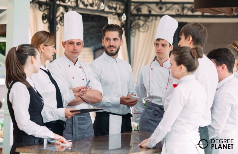 restaurant manager meeting with the kitchen staff