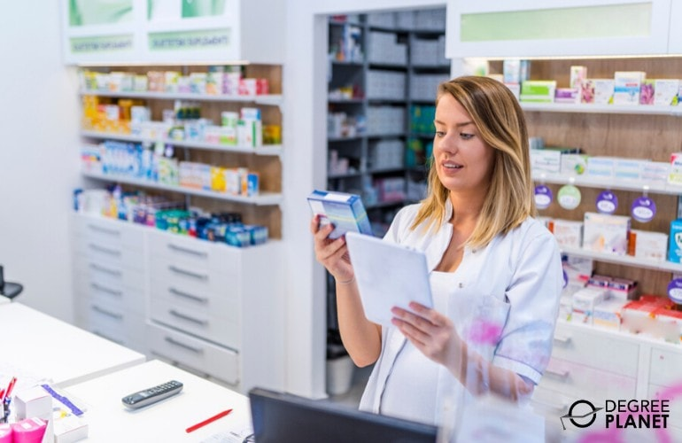 pharmacist checking label of medicine