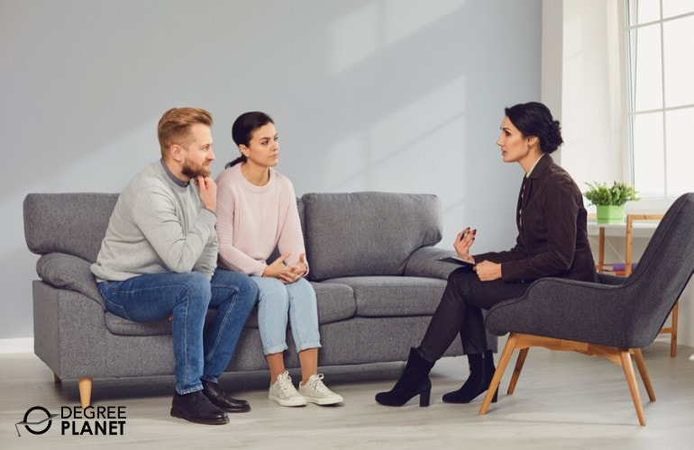 psychologist talking to a couple in her office