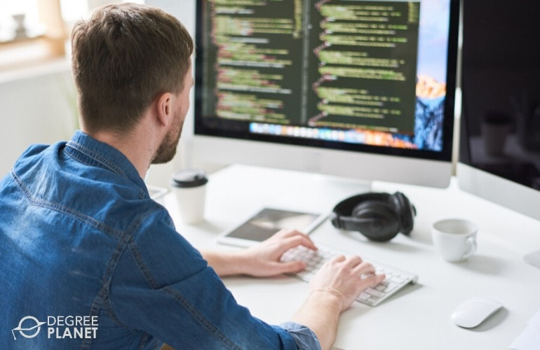 software developer working on his computer