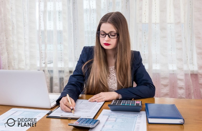 tax accountant filling up forms