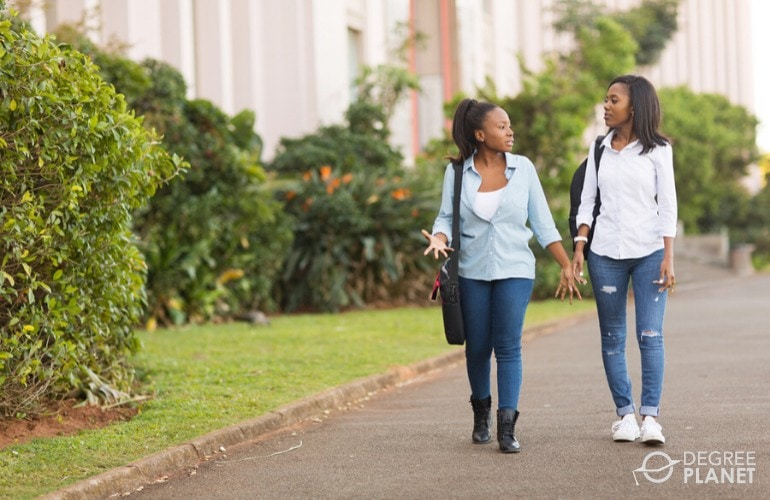 college students walking together on university campus