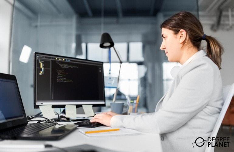computer programmer working on her desk