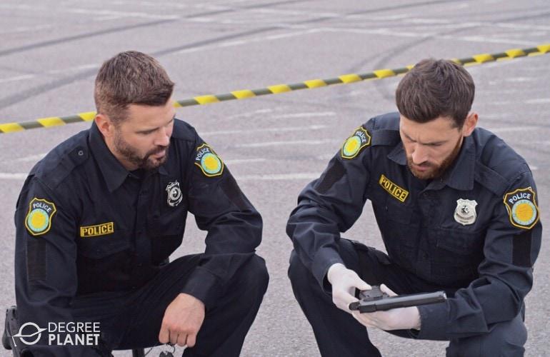 police investigators examining a crime scene