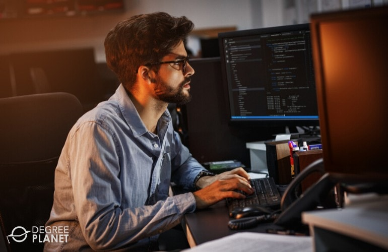cyber security analyst working on his computer