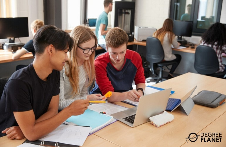 computer engineering students reviewing together