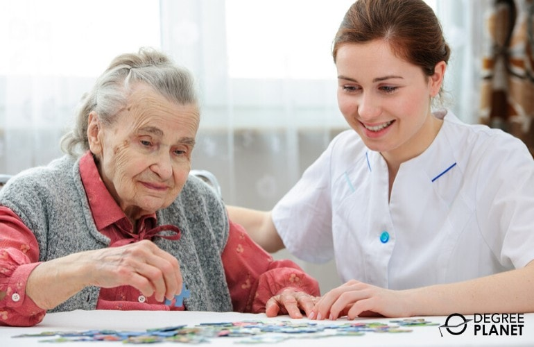 nurse taking care of an elderly woman