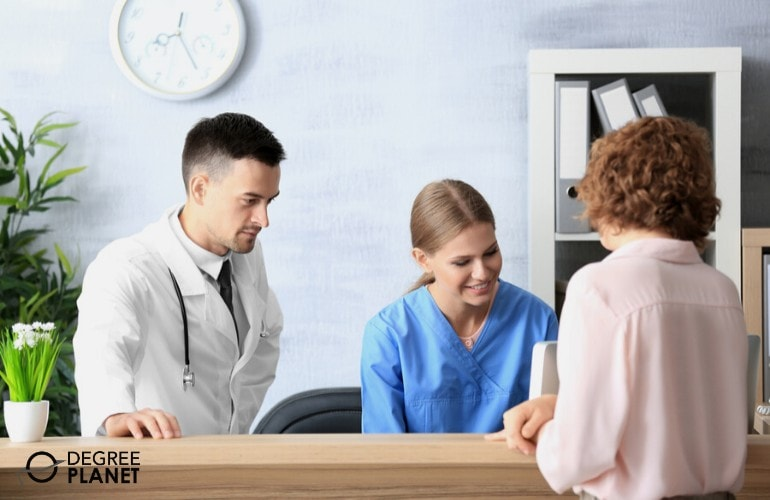 hospital receptionist talking to a client