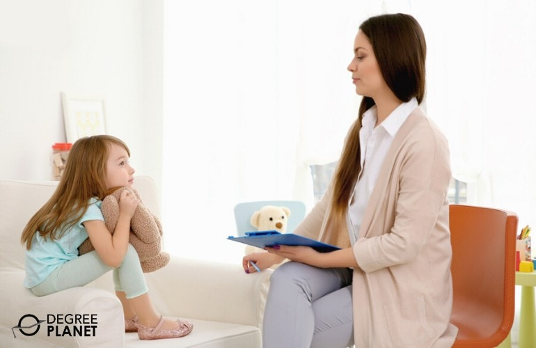 child therapist talking to a young patient in a clinic
