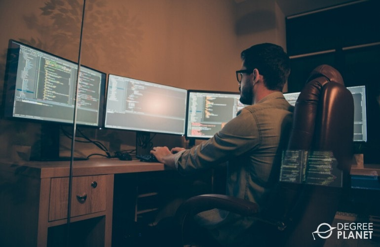 web developer working in his office