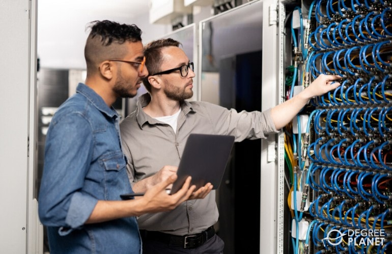 network administrators checking the data center