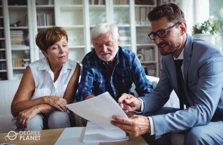 financial advisor talking to an elderly couple